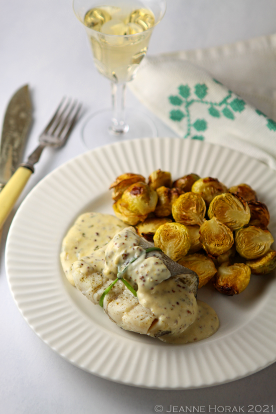 Baked dish in mustard sauce with brussels sprouts