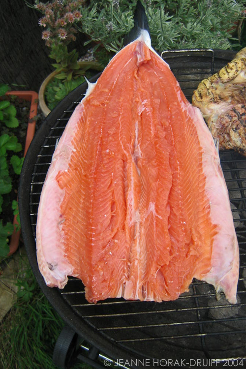 Whole butterflied salmon on the barbecue