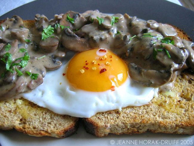 Creamy mushrooms on toast with fried egg