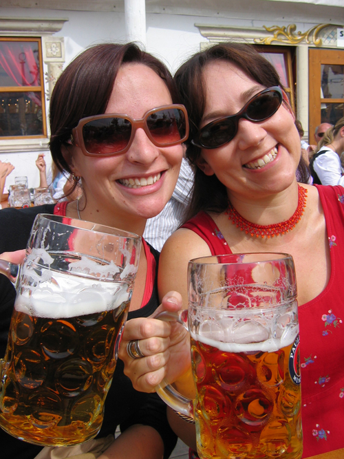Two women drinking beer at Munich Oktoberfest