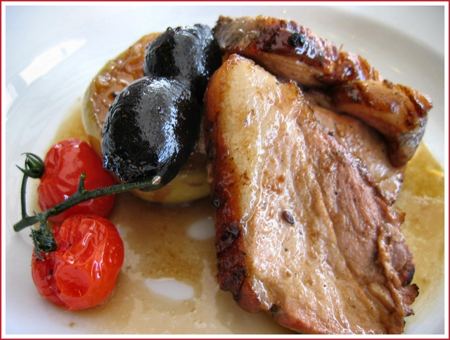 Pork chop with black pudding and tomato