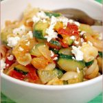 Zucchini, tomato and feta cheese sauce on gluten-free pasta