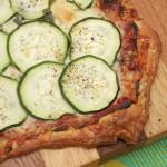 Zucchini, tomato pesto & Parmesan tart