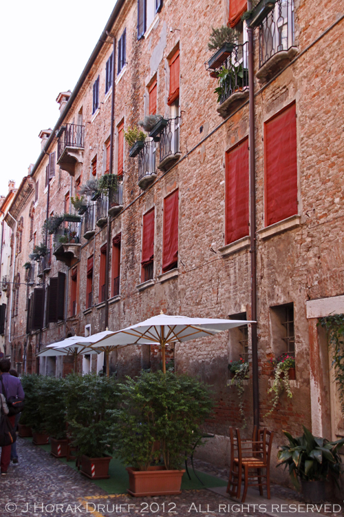 Ferrara old town red shutters © J Horak-Druiff 2012