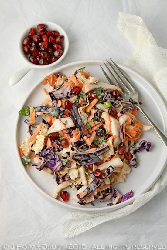 Spice up your coleslaw with the heat of harissa and the sweetness of pomegranate - a delicious twist on a classic!