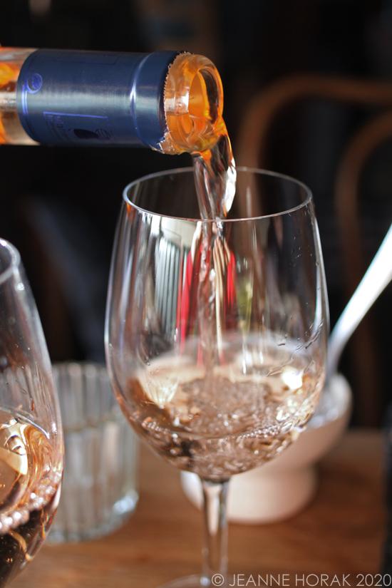 Pouring rosé wine