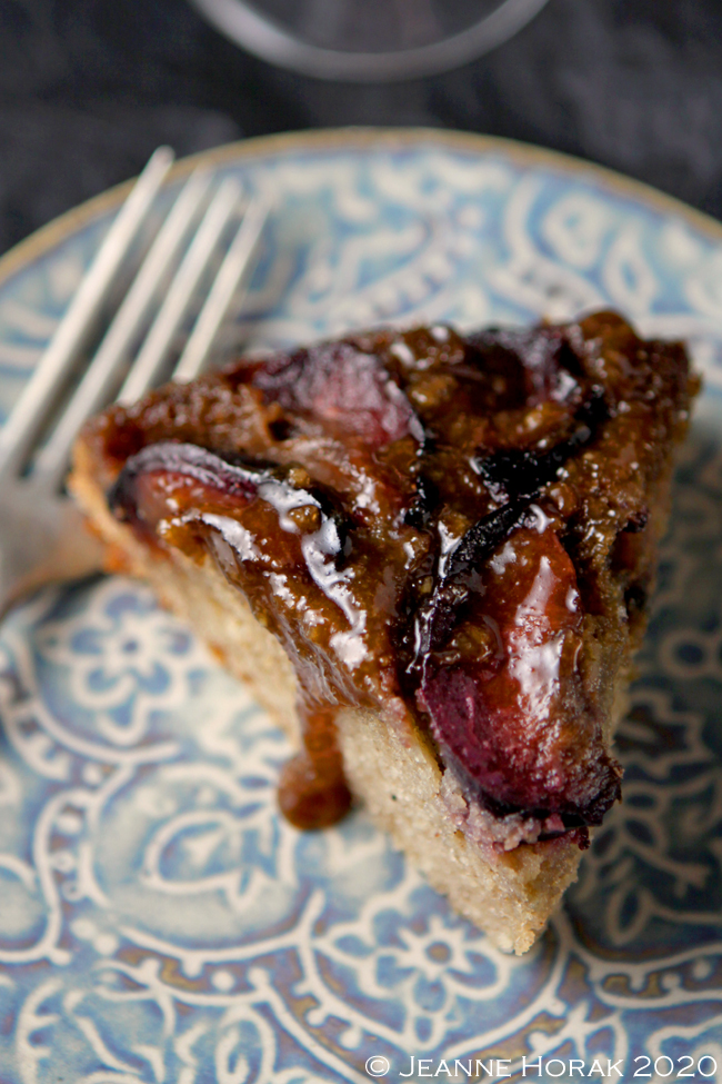 Slice of plum upside down cake