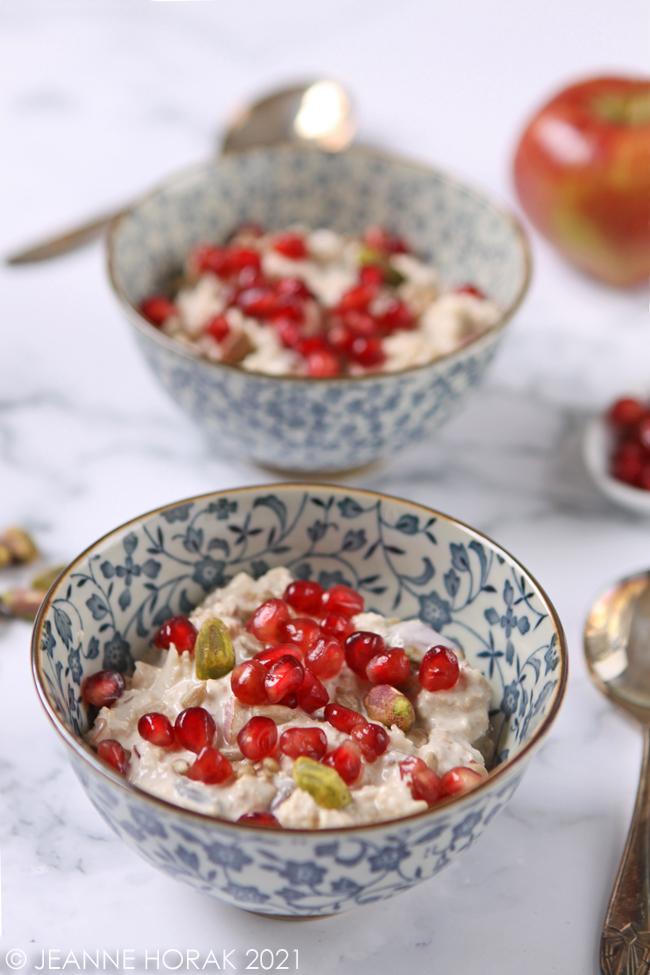 bowls of pistachio pomegranate bircher muesli