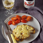 Cauliflower topped steak with melted cheese